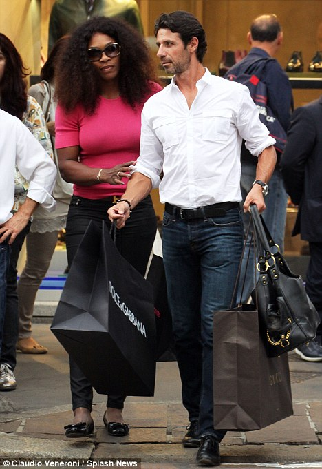 Wimbledon, U.S. Open, and French Open tennis star Serena Wiilliams, shopping in Milan with her coach Patrick Mouratoglou.