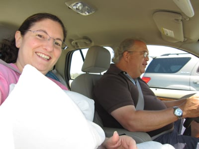 Holding my pillows in the car. Mark keeps me laughing.