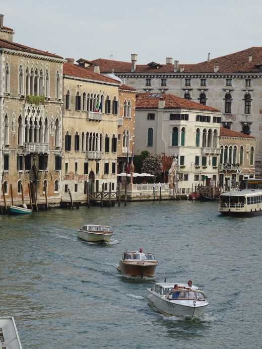 A parade of water taxis in Venice
