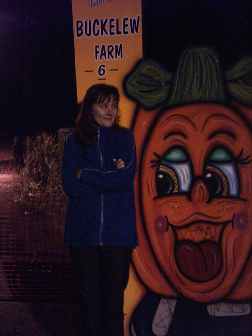 My wife shivering on Halloween as we await the start of the haunted cornfield tour