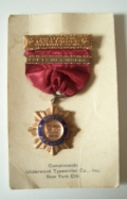 Antique typewriter speed medal