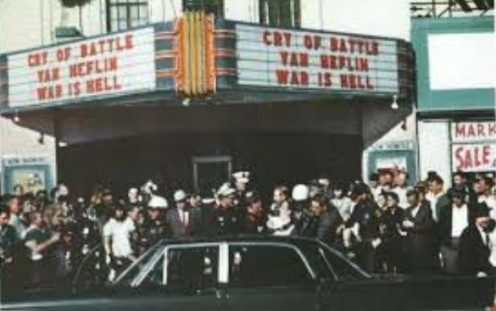 Moments after police tracked Lee Harvey Oswald to the Texas Theatre in Dallas. Notice the titles of the double feature on the marquee