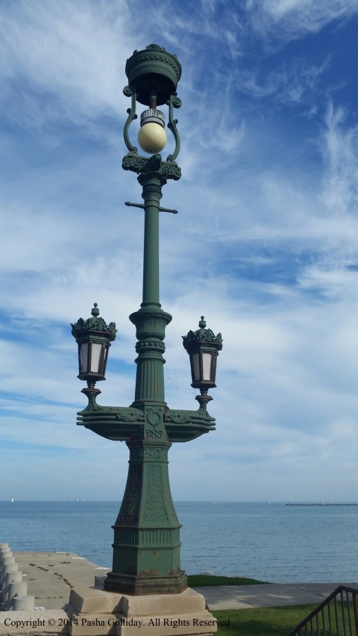 One of four original Columbian Exposition iron Lanterns on Harvey Gordon Clark Memorial Bridge located 59th and Lake Shore Drive, Chicago, IL.. Copyright © 2014 Pasha Golliday. All Rights Reserved