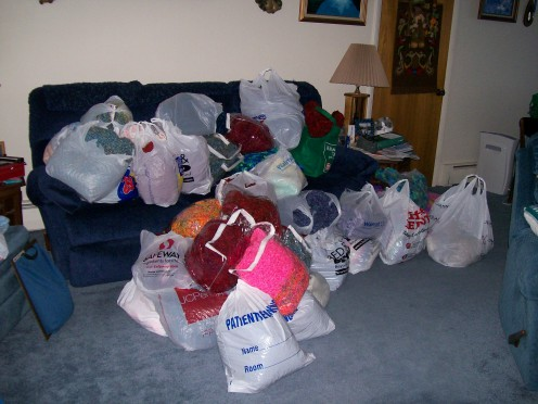 Bags and bags of afghans to donate.