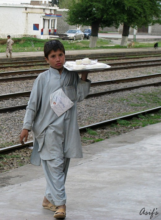 A child selling sweets at a railway station