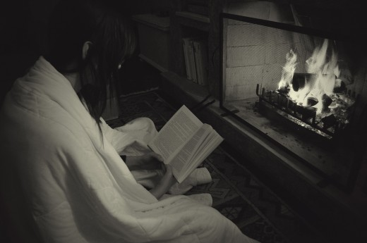 Reading by a Fireplace