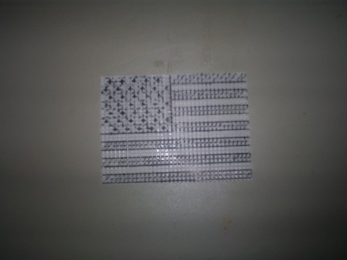 Use black marker to draw out the shape of Old Glory.