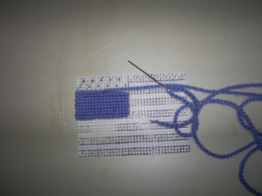 Continue stitching on the blue canton of the flag until this portion is complete.