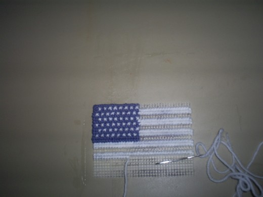 It is exciting to watch the American flag magnet take shape as you cross stitch it together.