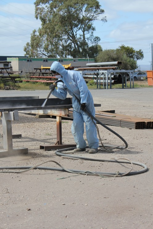 Wet abrasive blasting in action