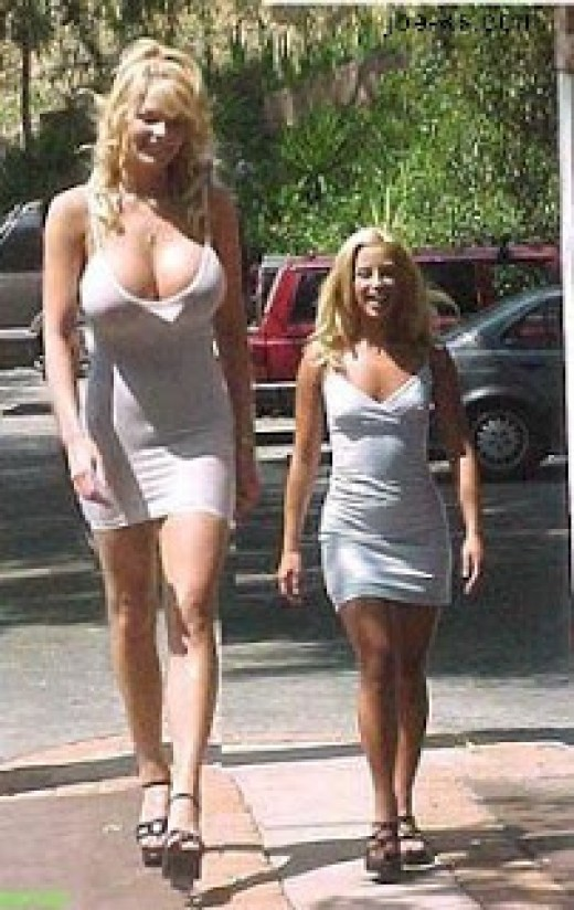 The woman on the left would not have taken any rudeness from a cave man. The woman on the right wouldn't have to either, they'd be all nervous around her, jumping around saying oo-ooo-ah-ah.