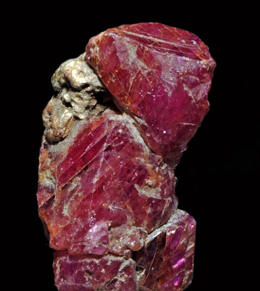 Raw ruby, http://commons.wikimedia.org/wiki/File%3ACorindons_rose_et_pourpre_(20_mm)_var._rubis_(Pakistan).JPG