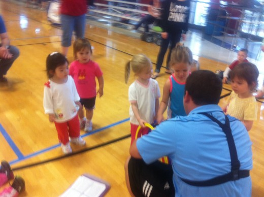 Sports coach at work teaching young children