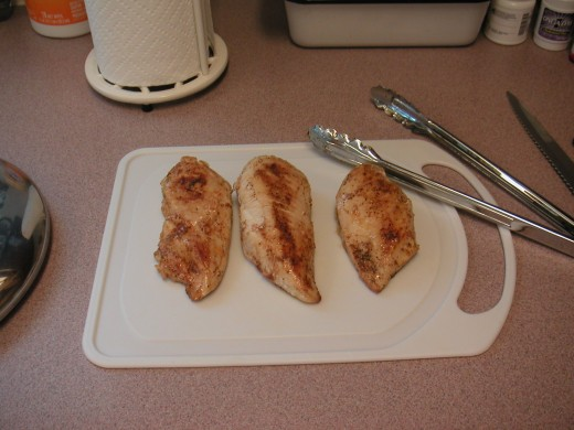 Let the chicken rest on a cutting board for a few minutes to allow the juices to settle before cutting.