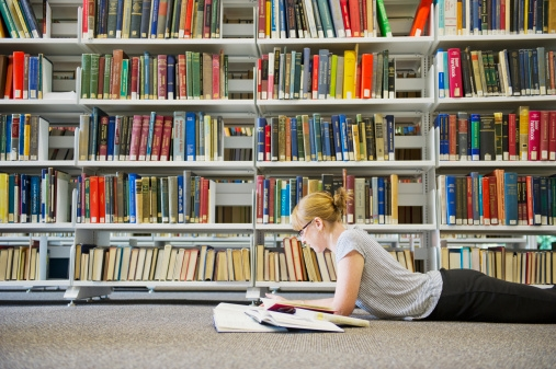 Having a relaxing read in the library.