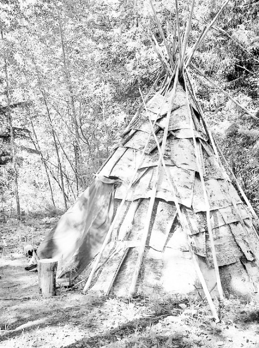 Wigwam formed of tree bark, poles, and cloth materials, often deer skins.