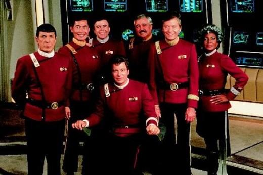 The cast of Star Trek: The Original Series on the set of Star Trek V.  From left: Leonard Nimoy, George Takei, Walter Koenig, James Doohan, DeForest Kelley, Nichelle Nichols and William Shatner (seated in front).