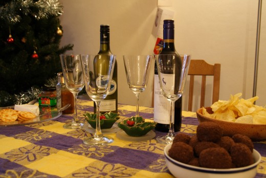 A colorful yellow and purple Christmas tablecloth