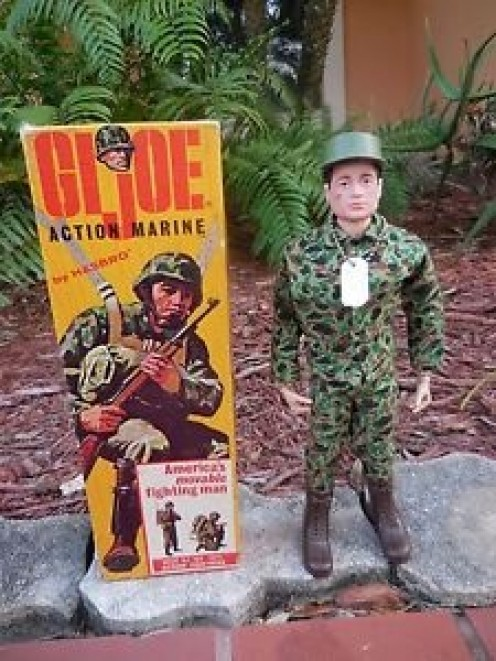 The 1964 G.I. Joe Marine with the paperwork is worth,$225.00 on Ebay.