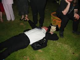 Poor best man. He drank too much booze and decided to take a nap