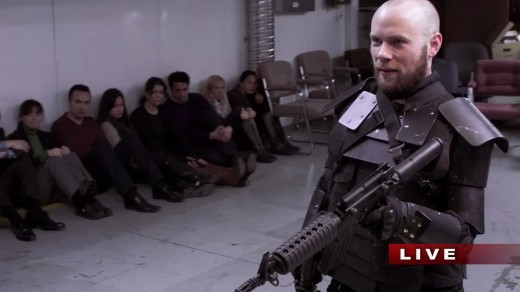 Bill Williamson(Brendan Fletcher) holding hostages in the basement of the TV station