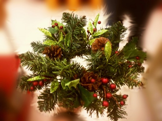 Wreath with pine cones and red berries