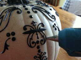 Hot (or warm) glue will make sure the embellishments stay in place.
