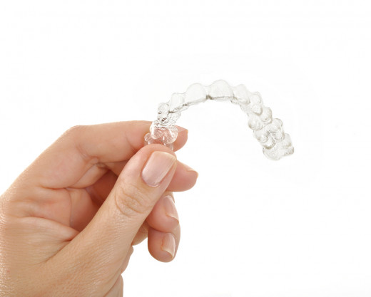 Invisalign clear aligners have many cosmetic benefits and are a good alternative to traditional braces.