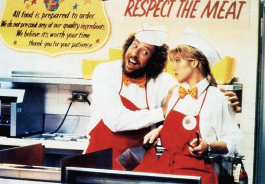 Mr. Egg (Frank Dent) loves his job as he trains not-so thrilled Christina Applegate in Don't Tell Mom the Babysitter's Dead
