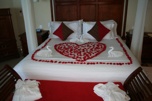 Suite with Rose Petals on Bed