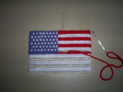 Here the red stripes are half way stitched.