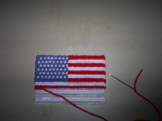 The red stripes are almost all cross stitched on.