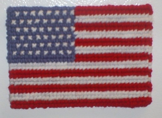 Here is the completed American flag cross stitched magnet.