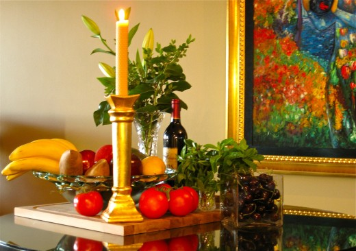 Instead of a useless decorative table centre, corral a cornucopia on a large wooden cutting board & clear up some counter space.