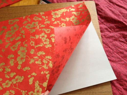 Step 7. Repeat the tape procedure in Steps 3 & 4, securing the art paper, design side up, against the backing.