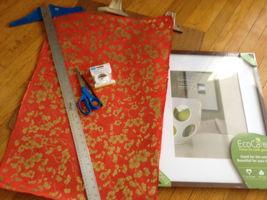 Step 1: Assemble your materials and tools and a soft pad to place under your hard work surface so you don't inadvertently score your table (or in my case, the floor) when you cut the paper. I used a small quilt.