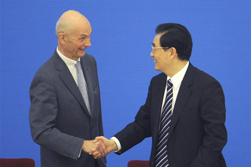 Former Chinese Premier: Hu Jin Tao shaking hands with Pascal Lamy, Director General of the WTO. Commemorating the 10 year anniversary of China's joining of the WTO.