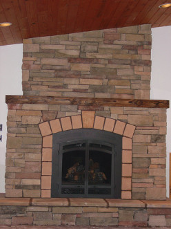 Beautiful stone and tile fireplace with no trace of that dated lava rock!