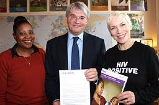 Annie Lennox with Memory Sachikonye amd Secretary of State for International Development, Andrew Mitchell, for World AIDS Day, 2011.