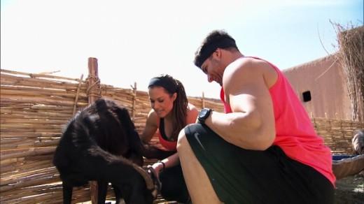 Brooke & Robbie milk a goat at the Detour.