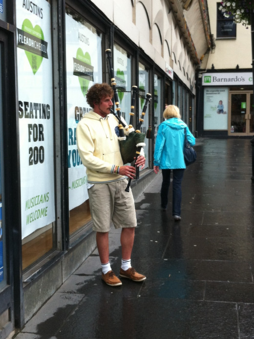 A piper busking