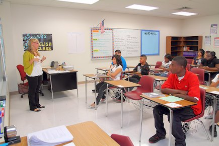 A brightly lit, colorful room with adequate spacing between seats makes learning enjoyable.