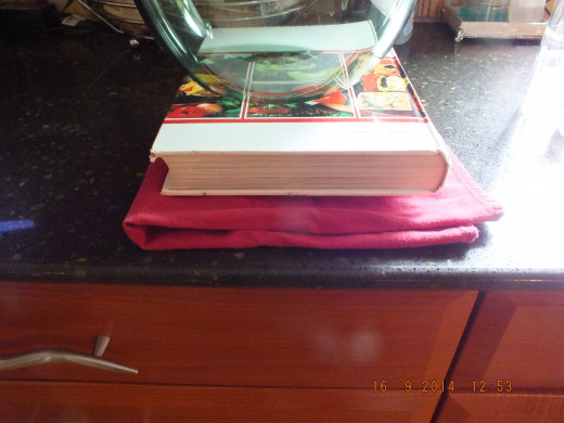 I then lay the other side of the tea towel over the tofu and added extra weight with the book. You can leave it like this while you prepare the other ingredients.