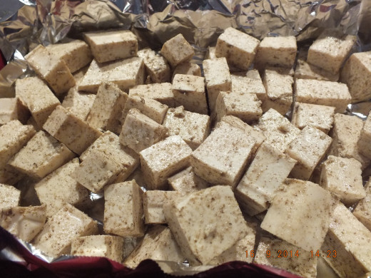 Add the tofu to an aluminum foiled lined baking dish and bake it at 425 degrees for 30 minutes.