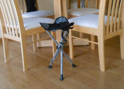 The Slacker Chair shown next to kitchen chairs