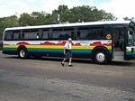 Many people like to travel by tour bus.