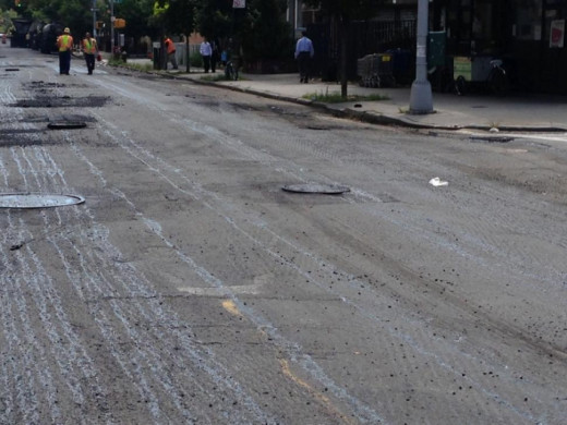 This is an example of a torn up street waiting to be repaved.