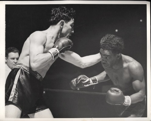 Willie Pep beat Chalky Wright by decision to win the featherweight championship.