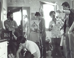 : Director of Photography Michael Chin (left with beard) and sound recordist Curtis Choy (with cup, center) on location in an indie film shoot in San Francisco, California 1983. Photo by Nancy Wong.