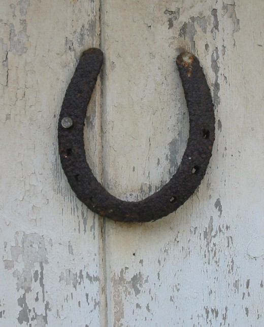 A horseshoe, open end up, on a door is believed to be a protective talisman in many cultures.